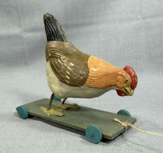 PAPER MACHE &WOOD PULL TOY ON WHEEL PECKING ROOSTER CHICKEN