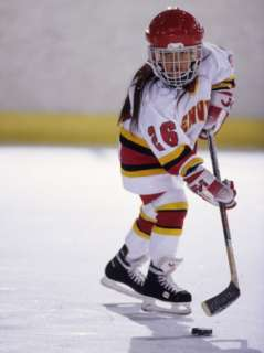 Young Girl Playing Ice Hockey Photographic Print at AllPosters