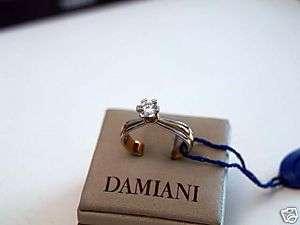 Anello solitario Damiani diamante oro bianco oro giallo