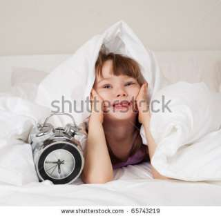 Cute Little Girl Unwilling To Wake Up In The Morning Stock Photo