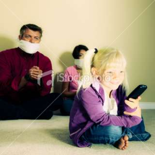 Lost Control   Little girl watching TV. Royalty Free Stock Photo